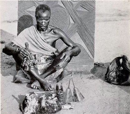 A medicine man with his stock in trade